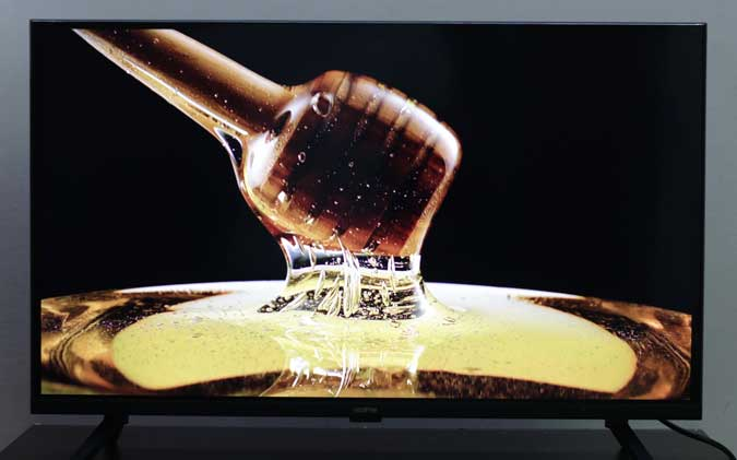 realme tv showing a picture of honey